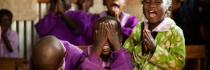 Preschool children praying before class in Eldoret, Kenya.